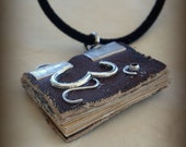 Om Dark Brown  Mini Book  Necklace  by Dryw on Etsy