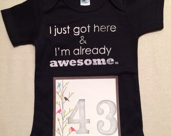 DISCOUNTED -- Nearly Perfect -- #43b, see photos -- I just got here & I'm already awesome.  -- black snapsuit, size 0-3 months