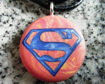 Super Hero hand carved on a polymer clay red and yellow color background. Pendant comes with a FREE 3mm necklace