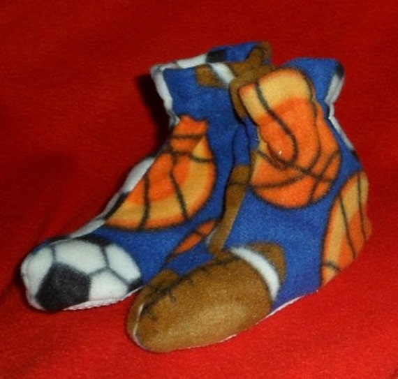 Child's Sports Slippers non-skid sole sz lg.  Blue fleece with basketballs, footballs, soccer balls