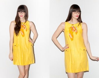 1960s Mod Yellow Swing Shift Dress with Circle Chest Cutout and Bow Sash. M/L