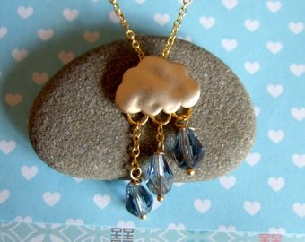 Cloudy rainy day necklace, gold plated chain, with gold rain cloud, and blue rain drops crystals