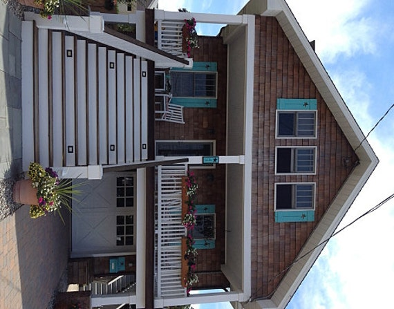 Shutter exterior interior one cedar wood beach by for Country shutters exterior