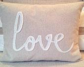 Tan chevron pillow, choice of white felt wording (love, relax, family...) & accent band on reverse; 12 x 16; feather insert, hidden zipper