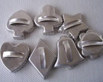 Vintage group of 7 metal cookie cutters with handles.  C8-102-0