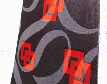 1940s  Van Heusen Geometric tie in dark blue, and red, with negative/positive satin swirl in fabric