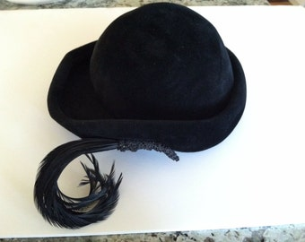 Vintage black velvet hat with feather accent