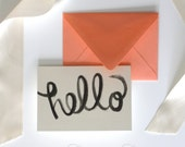 """Hello Note Card, Folded with Envelope, featuring my hand painted """"hello"""" watercolor illustration in black with coral envelope, great gift"""