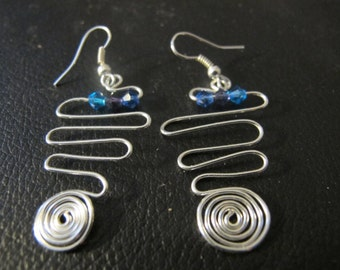 Silver wire wrapped earrings with geometric spirals and crystals