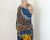 African Print girl's pinafore jumpsuit shorts in a bright abstract design