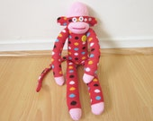 Red and turquoise polka dot sock monkey with vintage yellow button