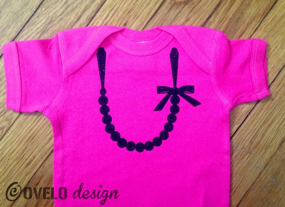 The Carrie Pearl Sparkle Glitter Necklace with Bow on Black Bodysuit with Pink Necklace