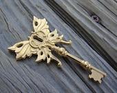 Butterfly winged skeleton key pendant gold plate