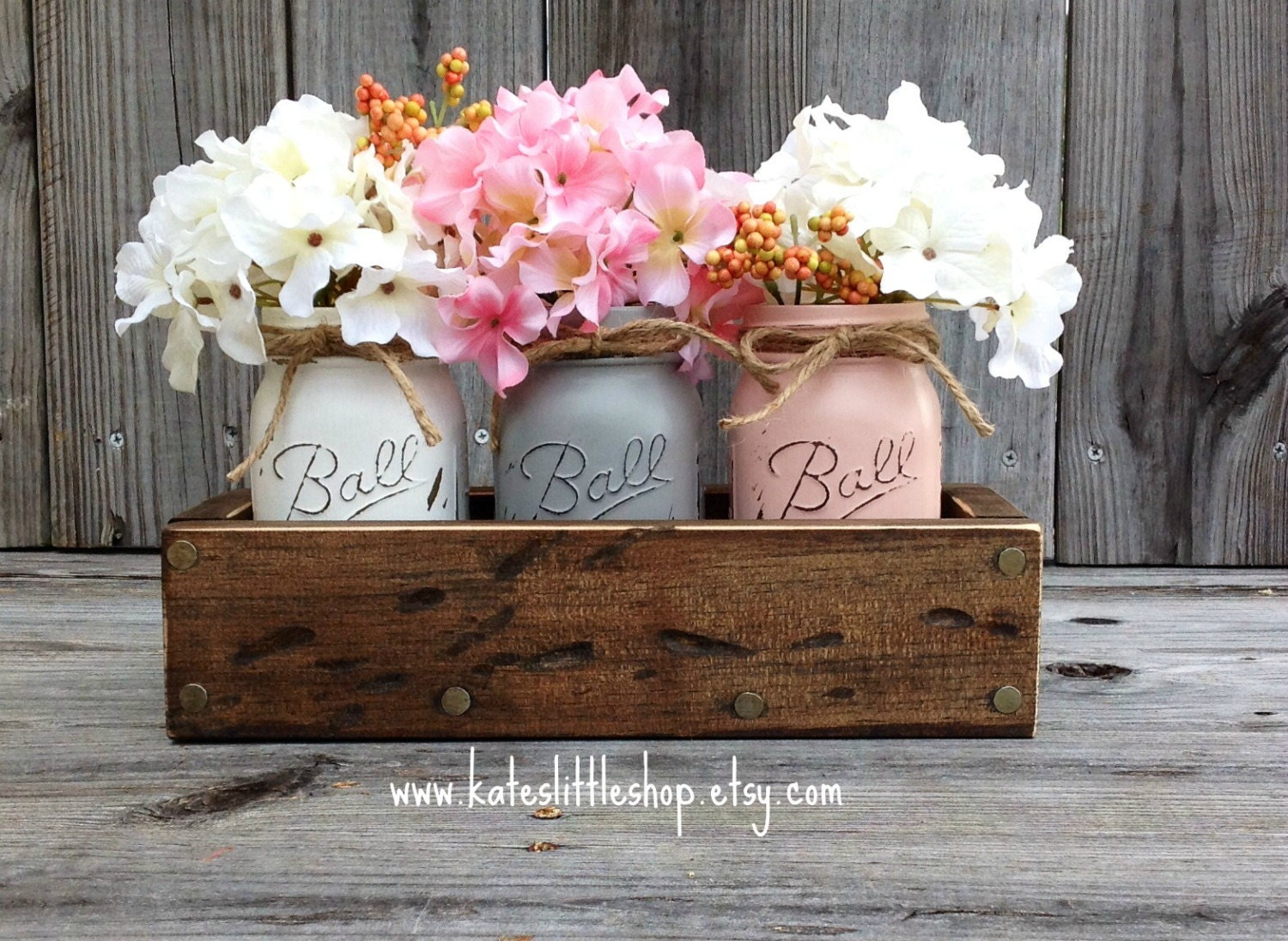 Rustic planter box with painted mason jars by