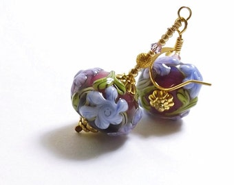 Purple Flower Earrings, 1 3/8 inches (3.5cm) Drops, Dark Purple Glass Beads Decorated with Light Purple Flowers and Green Leaves