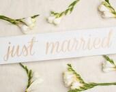 Wood block script JUST MARRIED sign