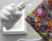 Jewel Tones -- Hand Holding Bulb Wall Lamp