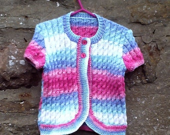 "Girls hand knitted self patterning short sleeve cardigan. 22"" chest."