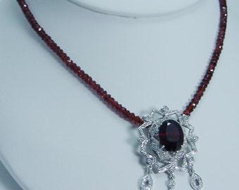 Designer Jewelry Doris Panos 18K Gold Garnet Diamonds Necklace Pendant