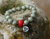 Green Wrist Prayer Beads with Triple Spiral Talisman