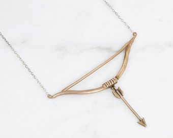 Bow and arrow necklace - brass on silver
