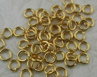 200 pcs - 0.7 x 3mm  Golden Plated Jumpring.