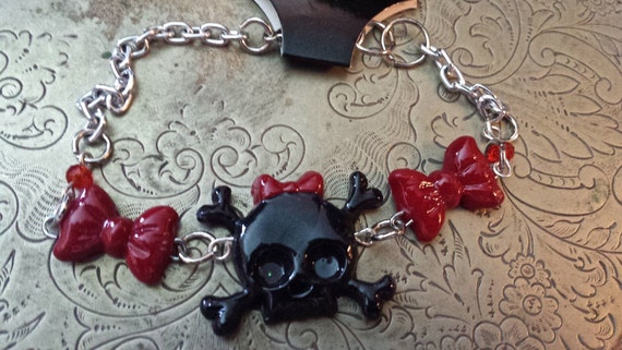 Black skull and cross bones with red bow bracelet by pandorasart