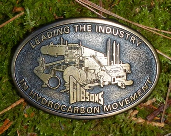 Vintage Brass Buckle Gibsons Leading the Industry in Hydrocarbon Movement