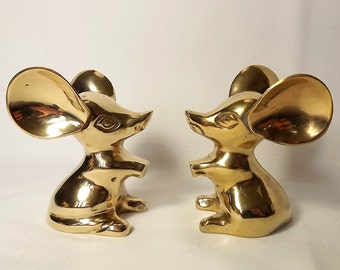 Two brass mice