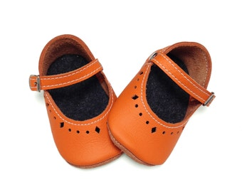 Orange leather soft soled baby shoes.  Infant shoes.  Mary Janes.