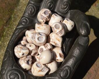 Small howlite skull beads in black & white