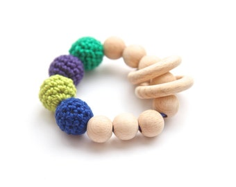 Blue, green, lilac teether. Teething ring toy with crochet wooden beads. Rattle for baby.