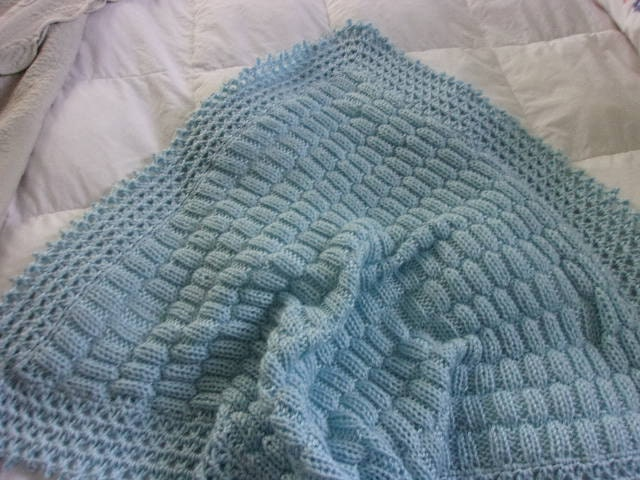 Baby Cot Blanket Knitting Pattern : Hand Knit Baby Blanket in a staggered rib stitch pattern with
