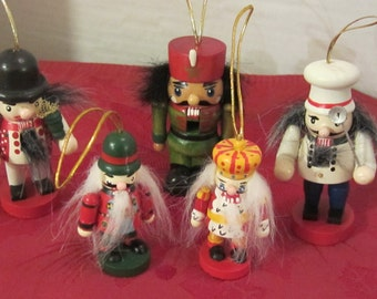A Collection of Five Vintage Wooden Tree Ornaments