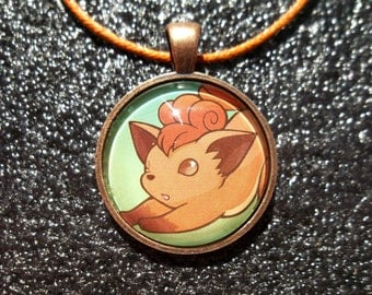 Vulpix Glass Charm Pendant made from Trading Cards