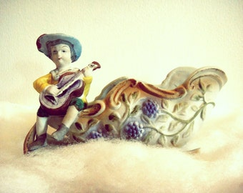 Antique Pottery Dutch Boy Playing Guitar Ukulele on Grape Embossed Sleigh Vase