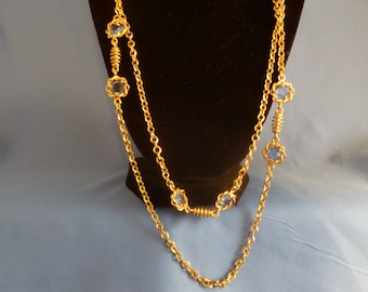 Long Gold toned with Blue Rhinestone Flower Necklace