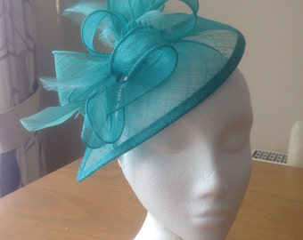 Turquoise Blue Fascinator and Feather Fascinator on a hairband, races, weddings, special occasions,Kentucky Derby, Melbourne Cup