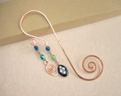 Swirly copper wire bookmark with copper spiral charm and blue and green toned glass bead accents