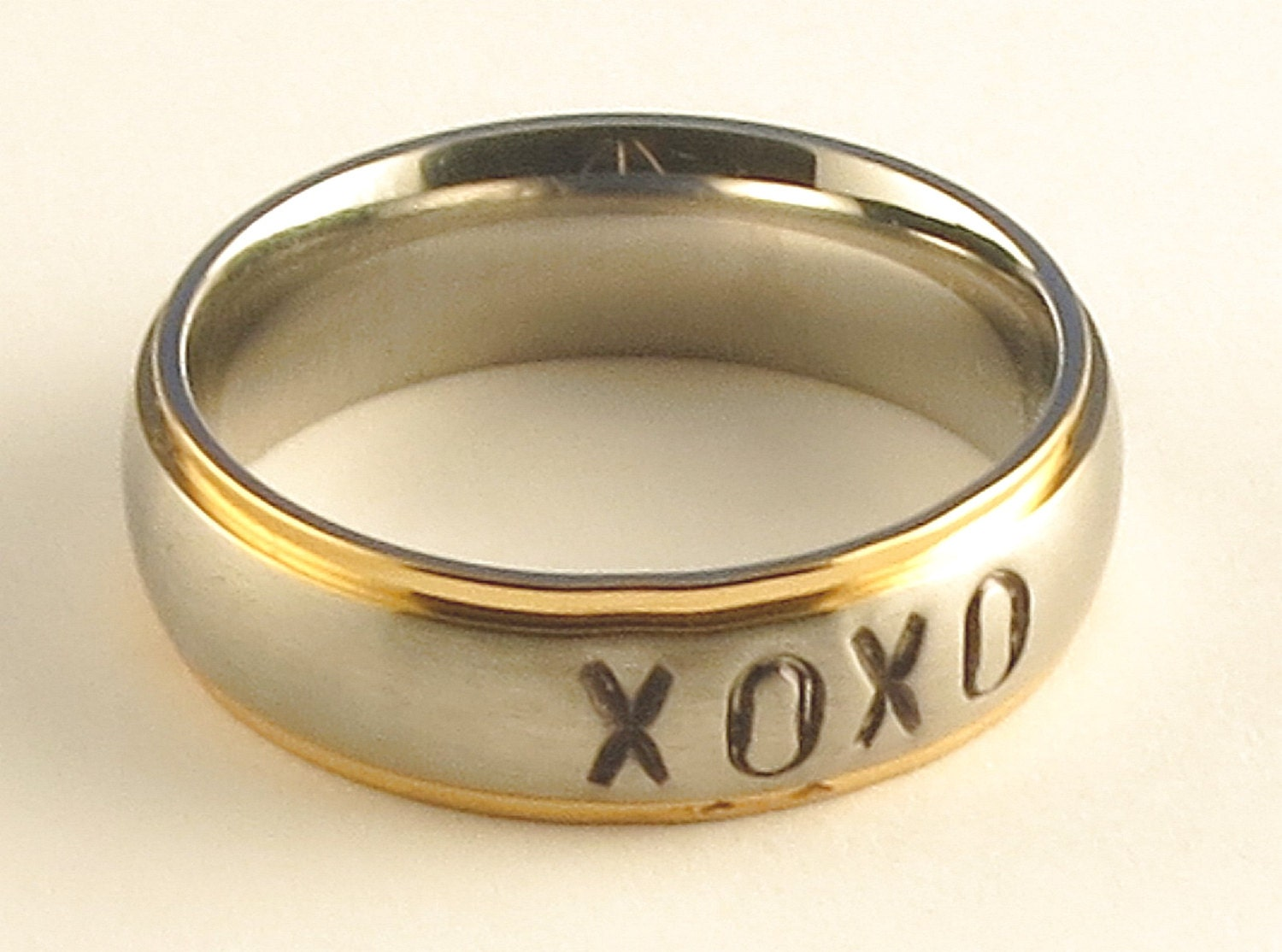 XOXO Stainless Steel Gold Tone Edge Comfort Fit Name Ring 6mm