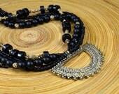 Bold ethnic Tibetan brass pendant Black mutistrand necklace Sophisticated multi layer torsade necklace Office stone jewelry