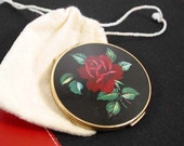 Stratton compact with rose and leaf design black and red gold tone