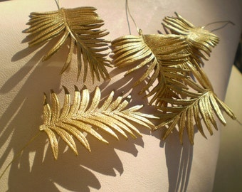 """One 2"""" metallic leather palm leaf with metal wire ."""