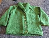 Hand knit little girl's bright green shawl collar cardigan