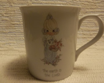 """1985 Precious Moments  porcelain cup """"The earth is the Lords"""""""