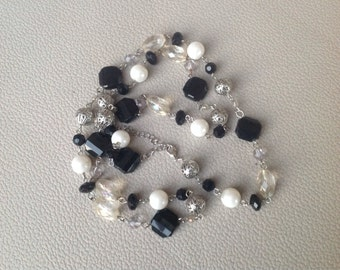 Beaded Necklace with Silver, Black, and White Beading