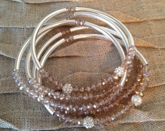 Set of 5 silver plated bangle bracelets with crystal beads.