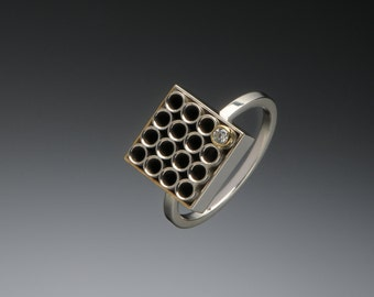 geometric silver and gold grid ring
