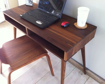 Boxer mid century modern desk with storage, featuring black walnut and tapered wood legs.