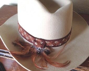 Smithbilt felt cowboy hat with feathers.